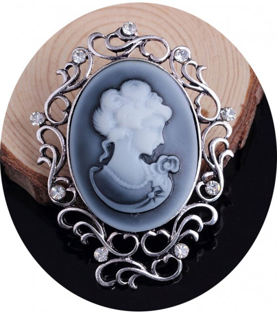 SB105 - Hollow Carved Brooch